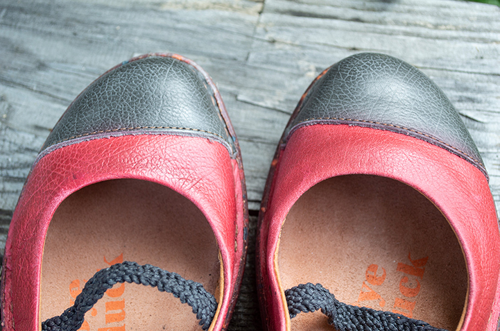 Red leather ballet flat with graphite leather toe.