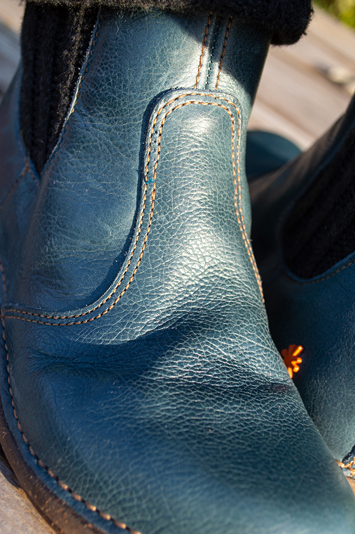 Ankle boots appear bluer in sunlight