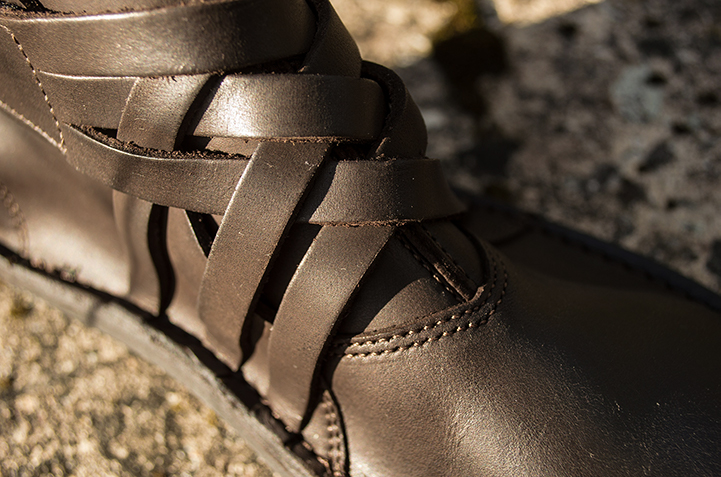 The leather strap is cut into three parts and sewn to the sole of the boot.