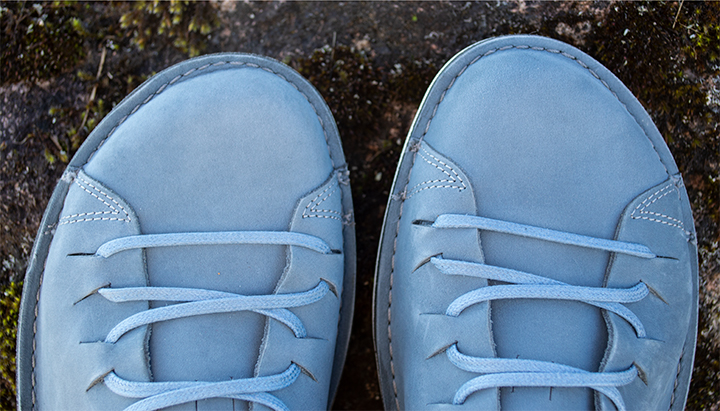Toes of casual shoes.  Nubuck shoe upper in daylight looks light blue.